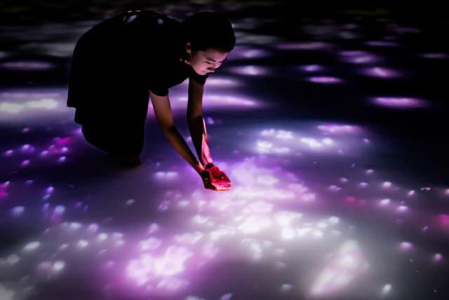 teamLab, ​Drawing on the Water Surface Created by the Dance of Koi and People - Infinity​ , 2016-2018, Interactive Digital Installation, Endless, Sound: Hideaki Takahashi  © teamLab  teamLab  is  represented  by  Pace  Gallery